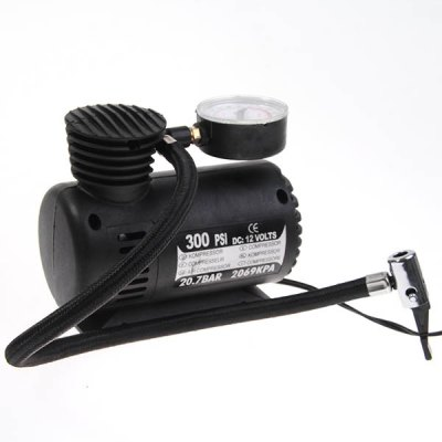 Portable Mini Car DC 12V 300 PSI Electrical Pump Air Compressor Tire InflatorCar Decorations<br>Portable Mini Car DC 12V 300 PSI Electrical Pump Air Compressor Tire Inflator<br><br>Product weight: 0.500 kg<br>Package weight: 0.550 kg<br>Product size (L x W x H): 7.00 x 1.00 x 4.00 cm / 2.76 x 0.39 x 1.57 inches<br>Package size (L x W x H): 17.00 x 9.00 x 13.00 cm / 6.69 x 3.54 x 5.12 inches<br>Package Contents: 1 x Air Compressor, 1 x Sports Needle, 2 x Nozzle Adapter