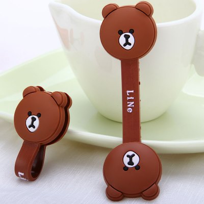 Dual Practical Cable Cord Wrap Manager Earphone Cable Winder with Brown Bear DesigniPhone Headsets<br>Dual Practical Cable Cord Wrap Manager Earphone Cable Winder with Brown Bear Design<br><br>Color   : Brown<br>Product weight : 14 g<br>Package weight : 0.043 kg<br>Product size (L x W x H) : 9.5 x 2.8 x 0.5 cm / 3.7 x 1.1 x 0.2 inches<br>Package size (L x W x H) : 12.5 x 10 x 1.8 cm<br>Package Contents: 2 x Cable Winder