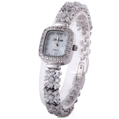 Tine 8011L Women Quartz Chain Watch with Diamond Steel Strap Reatangle DialWomens Watches<br>Tine 8011L Women Quartz Chain Watch with Diamond Steel Strap Reatangle Dial<br><br>Watches categories: Female table<br>Available color: Silver, Gold<br>Style : Diamond, Fashion&amp;Casual<br>Movement type: Quartz watch<br>Shape of the dial: Rectangle<br>Display type: Analog<br>Case material: Stainless steel<br>Band material: Stainless steel<br>Clasp type: Sheet folding clasp<br>Water Resistance : 30 meters<br>The dial thickness: 0.8 cm / 0.3 inches<br>The dial diameter: 2.0 cm / 0.8 inches<br>The band width: 1.0 cm / 0.4 inches<br>Product weight: 0.037 kg<br>Package weight: 0.127 kg<br>Product size (L x W x H) : 18.8 x 2.0 x 0.8 cm / 7.4 x 1.0 x 0.3 inches<br>Package size (L x W x H): 10.6 x 7.2 x 6.4 cm<br>Package contents: 1 x Watch, 1 x Box