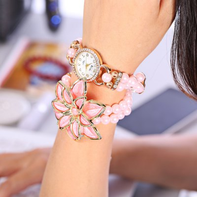 yilisha 2550 Flower Ladies Bead Chain Watch - yilishaWomens Watches<br>yilisha 2550 Flower Ladies Bead Chain Watch<br><br>Brand: yilisha<br>Watches categories: Female table<br>Available color: Pink, Red, Brown, Black, White<br>Style: Bracelet, Fashion&amp;Casual<br>Movement type: Quartz watch<br>Shape of the dial: Round<br>Display type: Analog<br>Case material: Alloy<br>Band material: Plastic and steel<br>Clasp type: Magnetic Clasp<br>The dial thickness: 0.8 cm / 0.31 inches<br>The dial diameter: 2.8 cm / 1.1 inches<br>The band width: 1.7 cm / 0.67 inches<br>Product weight: 0.053 kg<br>Package weight: 0.103 kg<br>Product size (L x W x H) : 39.5 x 2.8 x 0.8 cm / 15.52 x 1.10 x 0.31 inches<br>Package size (L x W x H): 20 x 5 x 2 cm / 7.86 x 1.97 x 0.79 inches<br>Package contents: 1 x yilisha 2550 Watch