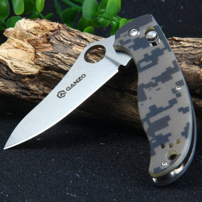 GANZO G733-CA Axis Lock 58HRC Pocket KnifePocket Knives and Folding Knives<br>GANZO G733-CA Axis Lock 58HRC Pocket Knife<br><br>Blade Edge Type: Fine<br>Blade Length: 8.2cm<br>Blade Length Range: 5cm-10cm<br>Blade Material: 440C Stainless Steel<br>Blade Width : 3.2cm<br>Brand: GANZO<br>Clip Length: 6.4cm<br>Color: Black,Green,Orange,Camouflage<br>For: Adventure, Home use, Travel, Mountaineering, Hiking, Camping<br>Handle Material: G10<br>Lock Type: Axis Lock<br>Model Number: G733-CA<br>Package Contents: 1 x G733-CA Axis Lock Pocket Knife, 1 x Knife Pouch<br>Package size (L x W x H): 13.50 x 5.20 x 3.00 cm / 5.31 x 2.05 x 1.18 inches<br>Package weight: 0.175 kg<br>Product size (L x W x H): 12.00 x 4.20 x 1.70 cm / 4.72 x 1.65 x 0.67 inches<br>Product weight: 0.122 kg<br>Unfold Length: 21.0cm<br>Weight Range: 101g-200g