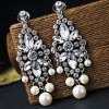 Pair of Graceful Faux Pearl Rhinestoned Hollow Out Earrings For Women for sale
