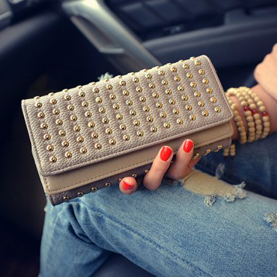 Trendy Rivets and Solid Color Design Wallet For WomenWomens Wallets<br>Trendy Rivets and Solid Color Design Wallet For Women<br><br>Wallets Type: Clutch Wallets<br>Gender: For Women<br>Style: Fashion<br>Closure Type: No Zipper<br>Pattern Type: Solid<br>Main Material: PU<br>Length: 19CM<br>Width: 4CM<br>Height: 10CM<br>Weight: 0.350KG<br>Package Contents: 1 x Wallet