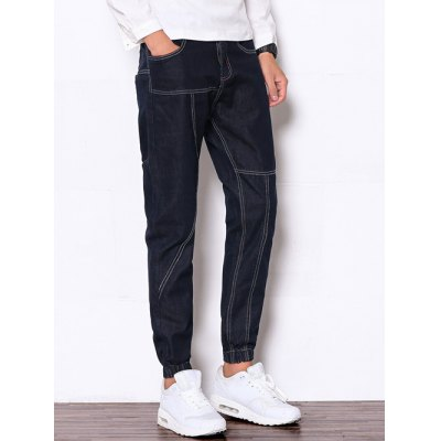 Zipper Fly Suture Design Beam Feet Denim Jogger PantsMens Jeans<br>Zipper Fly Suture Design Beam Feet Denim Jogger Pants<br><br>Material: Cotton,Jeans,Polyester<br>Pant Length: Long Pants<br>Wash: Medium<br>Fit Type: Regular<br>Waist Type: Mid<br>Weight: 0.750kg<br>Package Contents: 1 x Jeans<br>With Belt: No