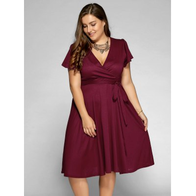 Plus Size Surplice Front Tie Swing DressPlus Size Dresses<br>Plus Size Surplice Front Tie Swing Dress<br><br>Style: Casual<br>Material: Cotton,Polyester<br>Silhouette: A-Line<br>Dresses Length: Mid-Calf<br>Neckline: V-Neck<br>Sleeve Length: Short Sleeves<br>Pattern Type: Solid<br>With Belt: No<br>Season: Summer<br>Weight: 0.526kg<br>Package Contents: 1 x Dress