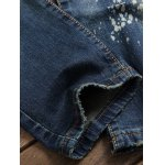 Scratched Zippered Pocket Rivet Paneled Ripped Jeans photo