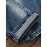 Pocket Zippered Scratched Distressed Jeans photo
