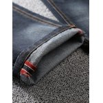 Zip Fly Scratched Tapered Jeans photo