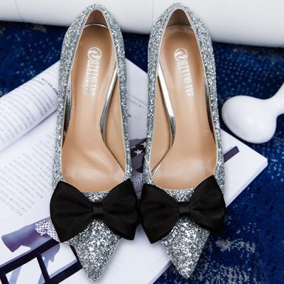 Glitter Bow Mini Heel PumpsWomens Pumps<br>Glitter Bow Mini Heel Pumps<br><br>Embellishment: Bowknot<br>Heel Height: 10CM<br>Heel Height Range: High(3-3.99)<br>Heel Type: Stiletto Heel<br>Occasion: Party<br>Package Contents: 1 x Pumps (pair)<br>Pumps Type: Basic<br>Season: Spring/Fall, Summer<br>Shoe Width: Medium(B/M)<br>Toe Shape: Pointed Toe<br>Toe Style: Closed Toe<br>Upper Material: Sequined Cloth<br>Weight: 1.5000kg