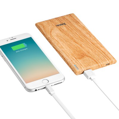 HOCO B10 Wood Grain Power Bank - 7000mAhPower Banks<br>HOCO B10 Wood Grain Power Bank - 7000mAh<br><br>Battery Capacity(mAh): 6001-7000<br>Product weight: 0.169 kg<br>Package weight: 0.352 kg<br>Package Size(L x W x H): 22.00 x 11.50 x 3.50 cm / 8.66 x 4.53 x 1.38 inches<br>Package Contents: 1 x Power Bank, 1 x Storage Bag, 1 x Cable