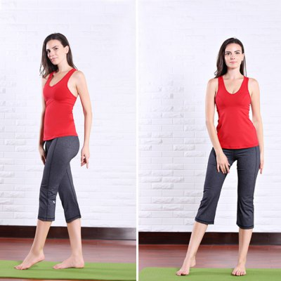 Фотография Female Exercising Yoga Vest