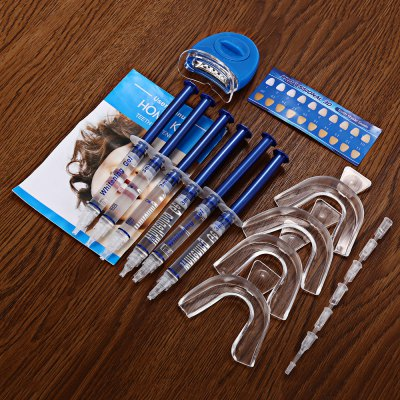 Dental Oral Care Teeth Whitening Kit with Bleaching LampTooth Care<br>Dental Oral Care Teeth Whitening Kit with Bleaching Lamp<br><br>Package Contents: 6 x Whitening Gel, 4 x Mouth Tray, 1 x Laser Light, 2 x 3V CR2032 Button Battery, 1 x English User Manual, 1 x Teeth Shade Guide, 6 x Syringe Cover<br>Package size (L x W x H): 22.00 x 16.00 x 5.00 cm / 8.66 x 6.3 x 1.97 inches<br>Package weight: 0.100 kg<br>Product weight: 0.070 kg