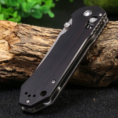 GANZO G7452 - WD2 Folding KnifePocket Knives and Folding Knives<br>GANZO G7452 - WD2 Folding Knife<br><br>Blade Length: 9.1cm<br>Blade Length Range: 5cm-10cm<br>Blade Material: 440C stainless steel<br>Blade Width : 2.2cm<br>Brand: GANZO<br>Clip Length: 6cm<br>Color: Black<br>For: Collecting, Adventure, Camping, Travel, Mountaineering, Home use, Hiking<br>Handle Material: Ebony<br>Lock Type: Axis Lock<br>Model Number: G7452 - WD2<br>Package Contents: 1 x GANZO Folding Knife, 1 x Drawstring Bag<br>Package size (L x W x H): 14.00 x 6.00 x 4.00 cm / 5.51 x 2.36 x 1.57 inches<br>Package weight: 0.188 kg<br>Product size (L x W x H): 12.00 x 3.00 x 2.00 cm / 4.72 x 1.18 x 0.79 inches<br>Product weight: 0.125 kg<br>Unfold Length: 21.1cm<br>Weight Range: 101g-200g