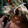 Frame Lock Folding Claw Knife with Camouflage Blade photo