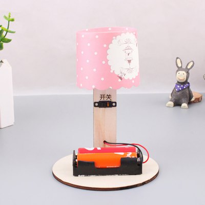 Table Lamp DIY 3D PuzzleScience &amp; Discovery Toys<br>Table Lamp DIY 3D Puzzle<br><br>Completeness: Semi-finished Product<br>Gender: Unisex<br>Materials: Other, Wood<br>Package Contents: 1 x Table Lamp Set, 1 x Operation Instruction<br>Package size: 20.00 x 10.00 x 10.50 cm / 7.87 x 3.94 x 4.13 inches<br>Package weight: 0.2500 kg<br>Product size: 15.00 x 10.00 x 10.00 cm / 5.91 x 3.94 x 3.94 inches<br>Product weight: 0.2000 kg<br>Stem From: China<br>Theme: Science