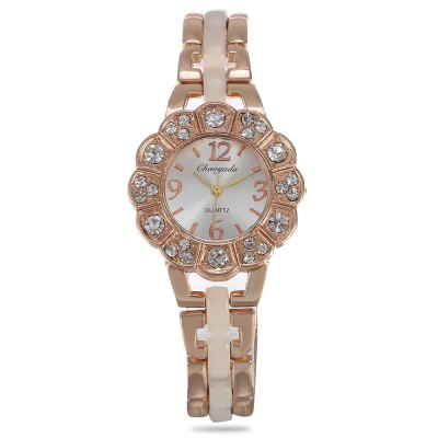 Chaoyada Flower Shaped Dial Female Quartz WatchWomens Watches<br>Chaoyada Flower Shaped Dial Female Quartz Watch<br><br>Band material: Alloy + Bronze<br>Band size: 20.90 x 1.50 cm / 8.23 x 0.59 inches<br>Brand: Chaoyada<br>Case material: Alloy<br>Clasp type: Sheet folding clasp<br>Dial size: 3.10 x 3.10 x 1.00 cm / 1.22 x 1.22 x 0.39 inches<br>Display type: Analog<br>Movement type: Quartz watch<br>Package Contents: 1 x Chaoyada Female Quartz Watch, 1 x Box<br>Package size (L x W x H): 8.50 x 8.00 x 5.50 cm / 3.35 x 3.15 x 2.17 inches<br>Package weight: 0.0550 kg<br>Product size (L x W x H): 20.90 x 3.10 x 1.00 cm / 8.23 x 1.22 x 0.39 inches<br>Product weight: 0.0450 kg<br>Shape of the dial: Petal Shaped<br>Watch mirror: Mineral glass<br>Watch style: Wristband Style<br>Watches categories: Women