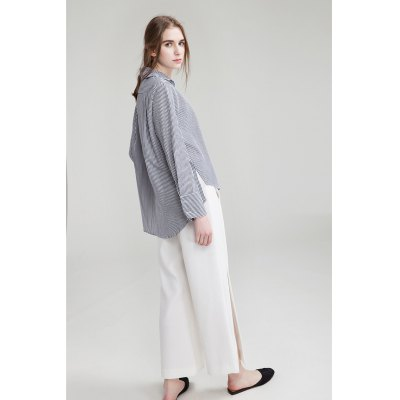 Side Slit Wide Cropped TrousersPants<br>Side Slit Wide Cropped Trousers<br><br>Closure Type: Zipper Fly<br>Fit Type: Regular<br>Length: Ninth<br>Material: Polyester<br>Package Contents: 1 x Pair of Pants<br>Package Size ( L x W x H ): 35.00 x 4.00 x 28.00 cm / 13.78 x 1.57 x 11.02 inches<br>Package Weights: 0.300<br>Pant Style: Wide Leg Pants<br>Waist Type: High